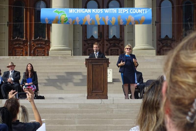 Lt. Gov. Brian Calley speaks on the Capitol steps about special education reforms at an October rally.