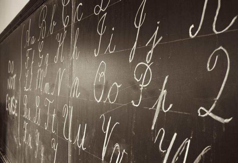 Cursive on a classroom chalkboard