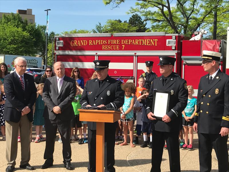 Grand Rapids Fire Department accept framed copy of 1974 Emergency Medical Services Week proclamation signed by President Gerald R. Ford.