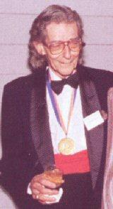 Claude Howell wearing the North Carolina Award medal he received in 1985 for fine arts.