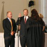 Councilman J.C. Hearne, being sworn in by Judge Criner.