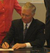 Easely signing the landfill moratorium.