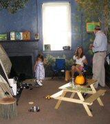 Mark Kesling, Executive Director, meets a family in the Traveler's Stories room.