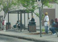 Riders wait for buses at WAVE's current hub on North 2nd Street.