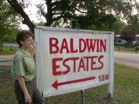 Park Manager Virginia Janelle stands by the entrance of Baldwin Estates.
