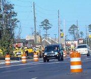 The DOT says it's only weeks away from removing those orange barrels from Military Cutoff Road.