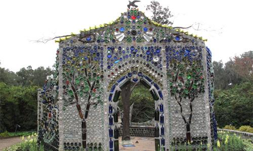 Minnie Evans Sculpture Garden and Bottle Chapel in Airlie Gardens, designed by artist Virginia Wright Frierson. Minnie Evans was the gatekeeper of Airlie Gardens from 1949 to 1974 and is considered to be one of America's most important visionary artists.