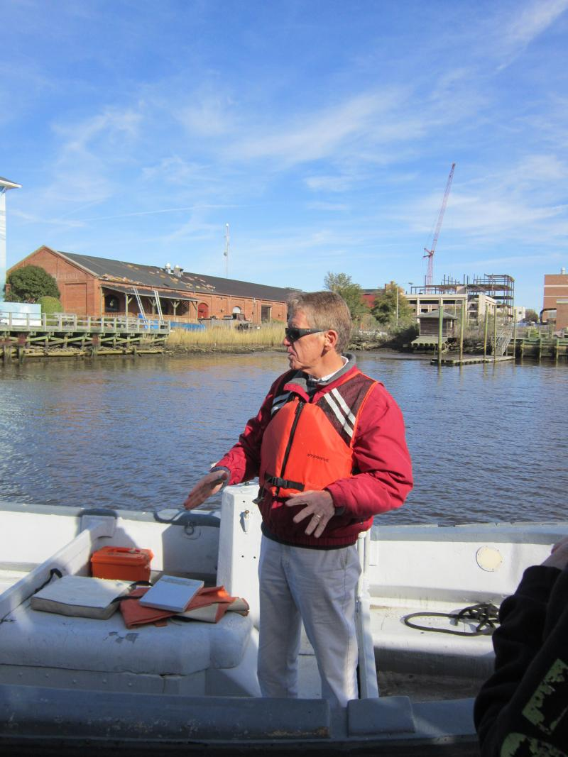 Captain Steve Beuth congratulates his students on completing their exam out on the Cape Fear River.