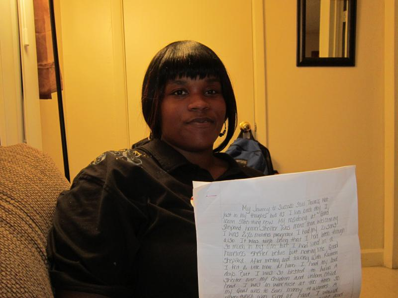 Sheera Randolph holds her neatly-scribed, four-page thank you letter to the staff at Good Shepherd, including her case manager Carmen Pope.