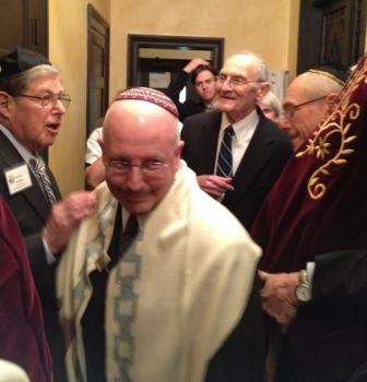 Rabbi Paul Sidlofsky scoots into place in the Torah procession before his installation on Friday.