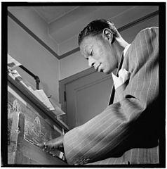 Nat King Cole where he belongs, at a piano