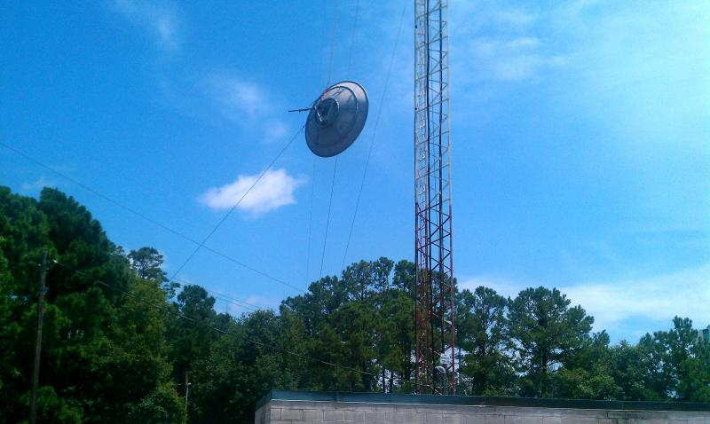 Not a flying saucer. An old dish comes down to make room for our antenna.
