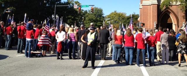 Supporters create human wall to protect family of Sgt. T.J. Butler at the funeral at First Baptist in Wilmington