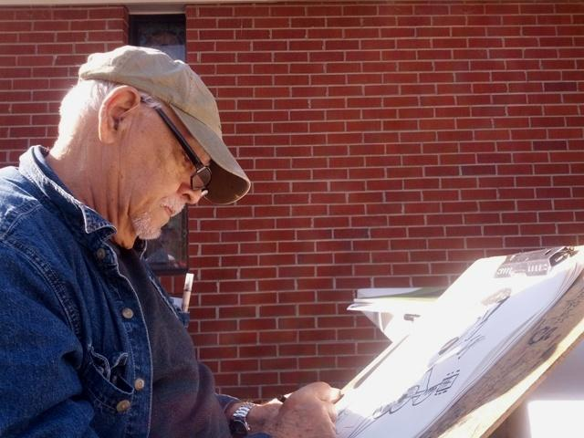 Bill Smith, caricature artist, sketching furiously on a Saturday