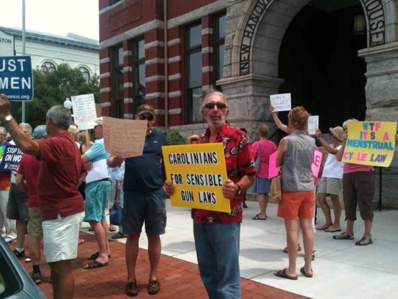 Protesters say downtown Wilmington's historic courthouse offers a more public demonstration space than the sidewalk outside state Senator Thom Goolsby's office.