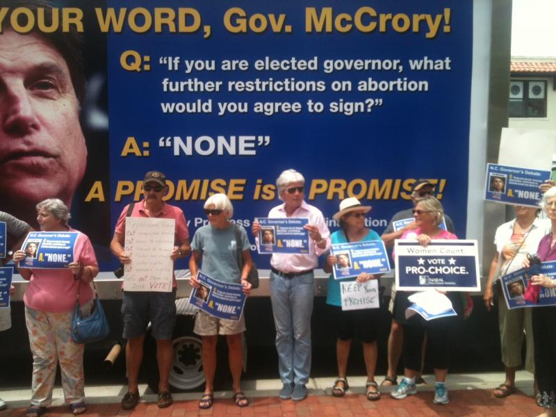 Local protestors flocked to the traveling billboard, which was paid for by ProgressNC Action's statewide donors.