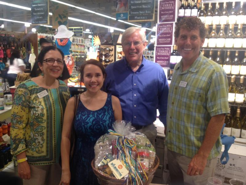 Whole Foods Market gift basket winner Sherri Dill with board chair David Zumbro, station manager Cleve Callison, and membership manager Mary Bradley