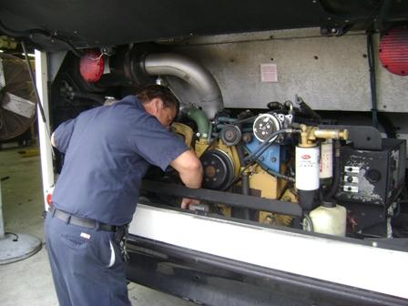 Mechanic working on an NHC school bus