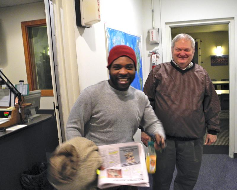 Program Director Bob Workmon welcoming actor Khawon Porter to the studio