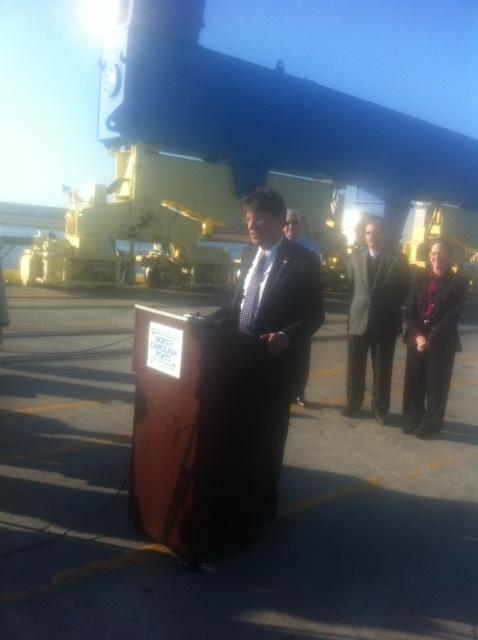 After operating a six-story crane, the governor addressed a small crowd of public officials and media members.