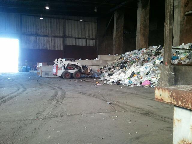 Piles of recyclable material at the defunct Wastec facility