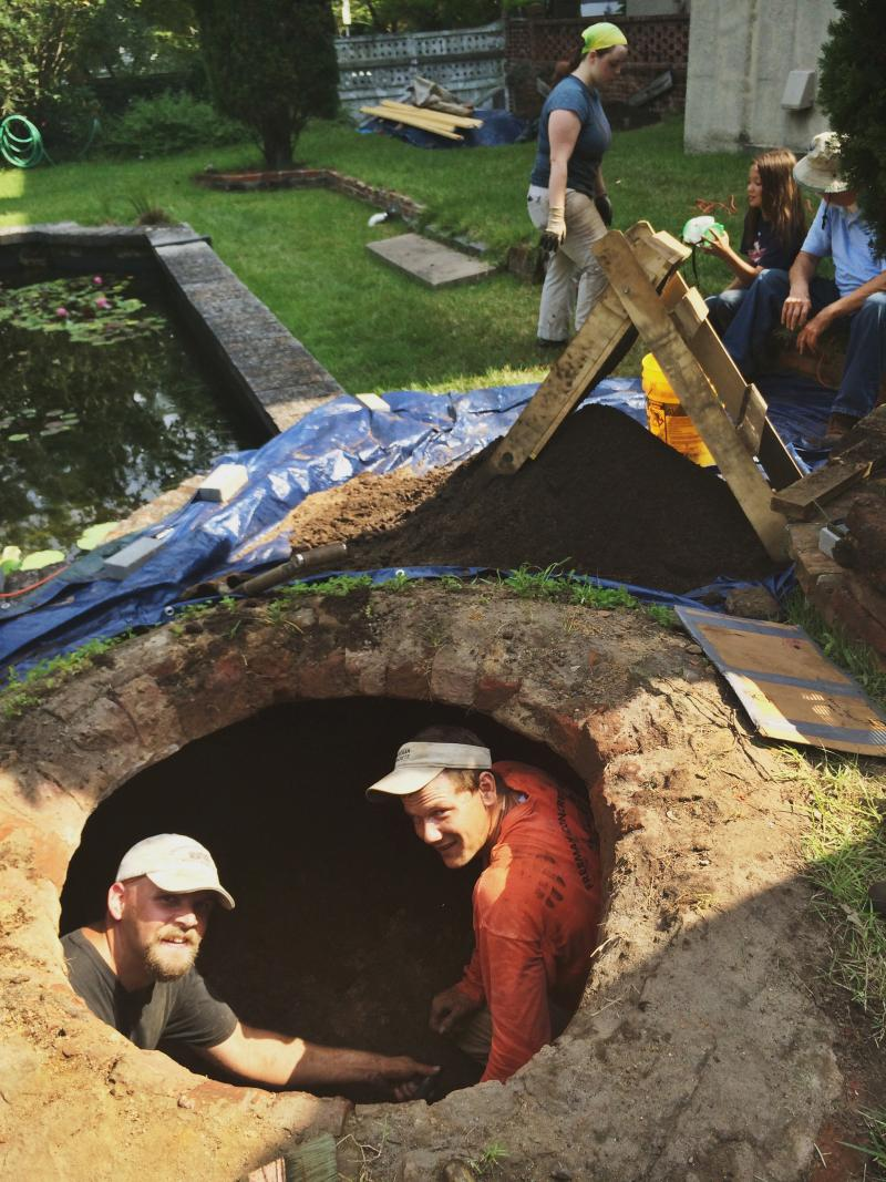 Jonathan Schleier (left), founder of Public Archaeology Corps, Justin Freeman (right), and volunteers work to excavate the historic cistern.