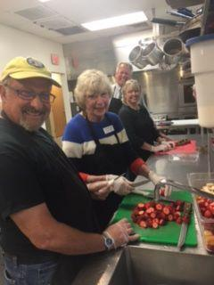 Preparing dinner at the Goo Shepherd Center. From left: Bob Waxman, Geneva Reid, MK. Cope, and Rob Zapple