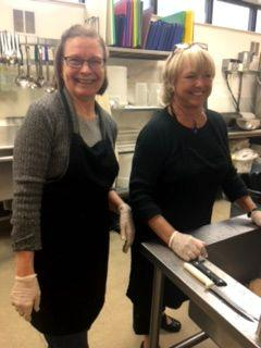 Dorothy Rankin and MK Cope having a great time serving up hot meals at the Good Shepherd Center