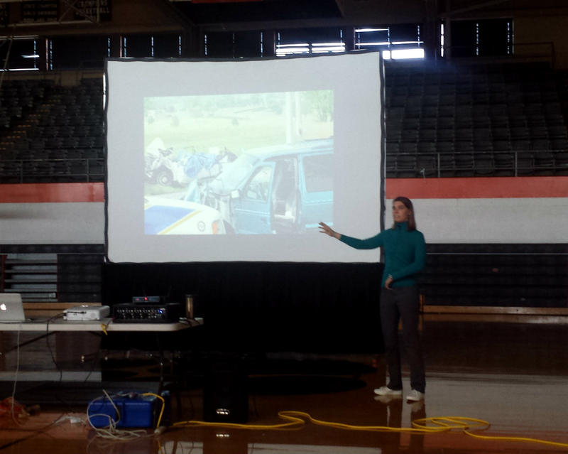 Jacy Good speaks to the senior class of New Hanover High School about the risks of cell phone use while driving.