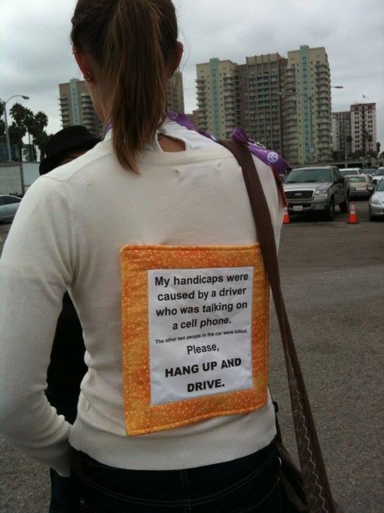 A sign Jacy wears on her back to raise awareness.