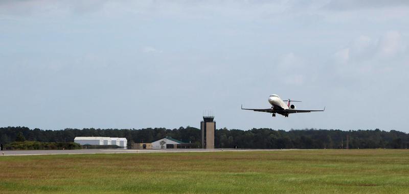 A flight departs Wilmington International Airport.