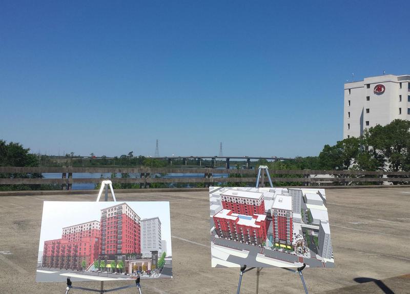 Artist renderings of River Place on display Monday.