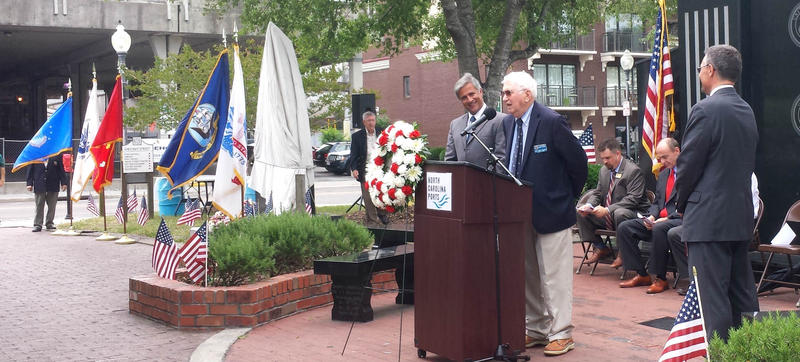 Mayor Bill Saffo looks on as Capt. Henry Helgesen, a retired U.S. Coast Guard officer, speaks at the dedication.