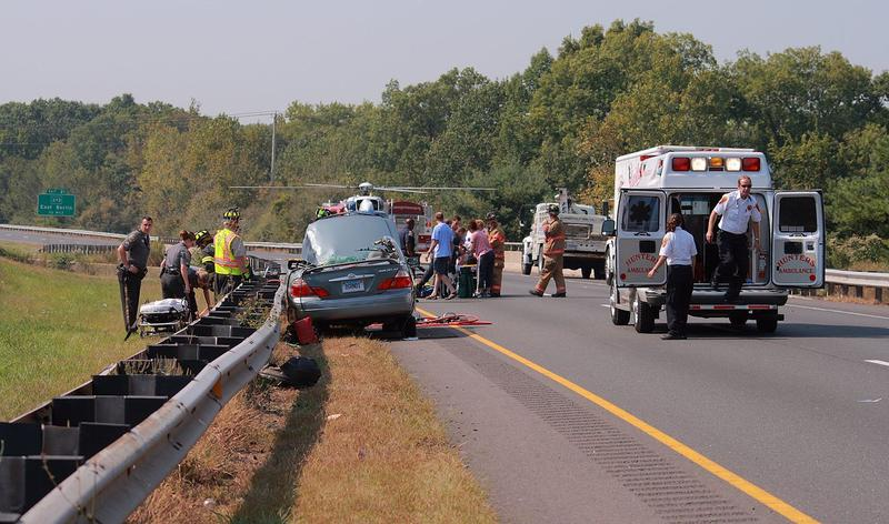 The scene of a traffic accident on highway 9 near New Britain, Connecticut. State troopers, local police, firefighters, paramedics, and a LifeStar helicopter are on the scene.