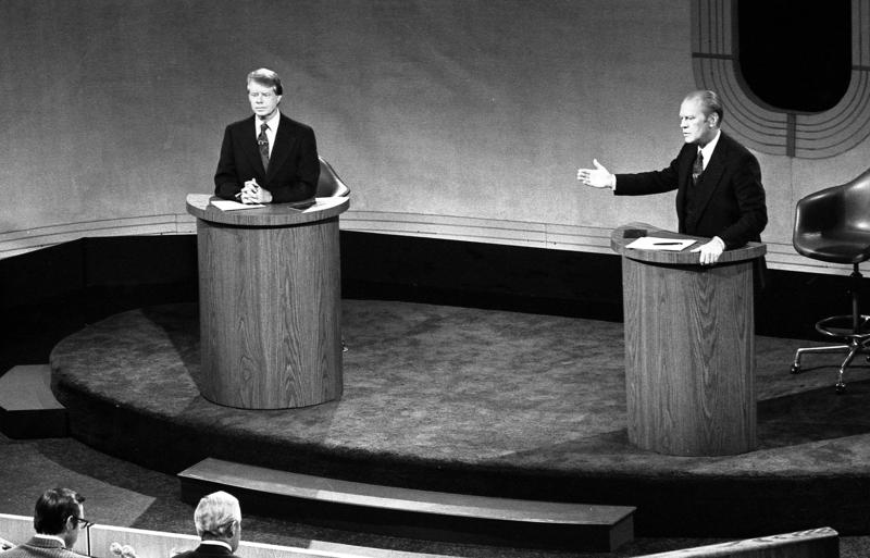 President Gerald Ford and Jimmy Carter meet at the Walnut Street Theater in Philadelphia to debate domestic policy during the first of the three Ford-Carter Debates.
