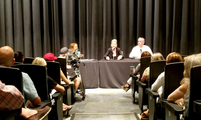 Erin Brockovich (center) and Robert Bowcock spoke at the Lumina Theater on Wednesday night.