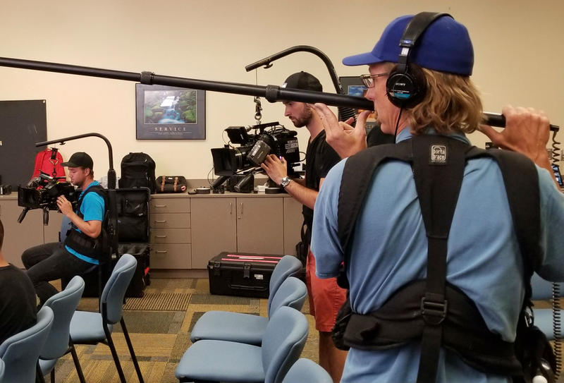 Two camera men and a sound engineer are part of the 15 person crew Brockovich brought to town for a documentary she is producing about herself.