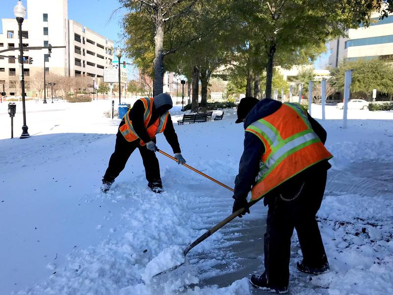 City of Wilmington Crews shovel snow after Winter Storm Grayson on Thursday, January 4, 2018.