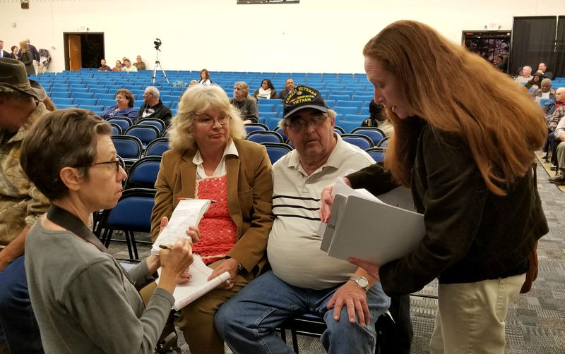 Journalist Lisa Sorg listens as (l. to r.) Elsie Dew, James Dew and Amanda Dew discuss their contaminated wells and lake.
