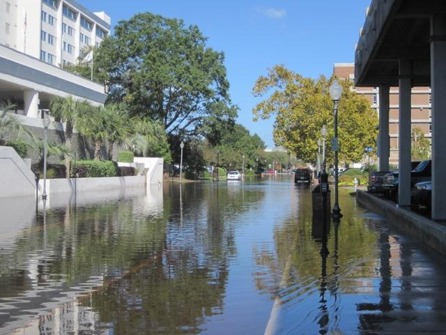 High tide coinciding with Hurricane Matthew 2016 on Water Street in downtown Wilmington, NC