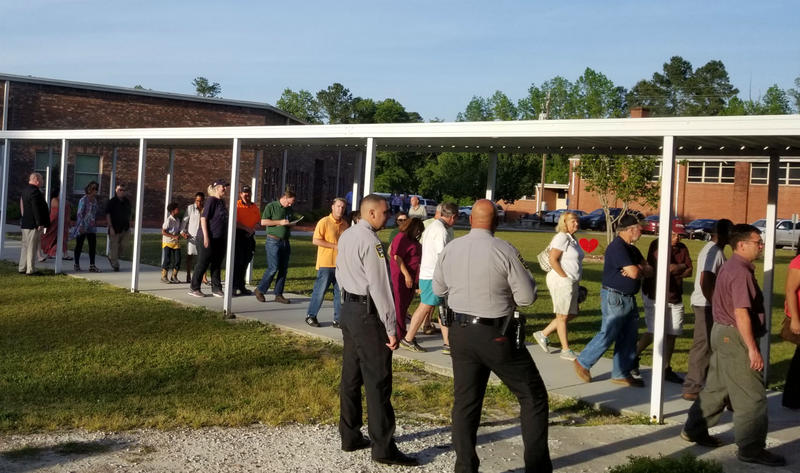 A steady stream of residents filled the middle school cafeteria, forcing the meeting to be moved to the gym when it reached capacity.