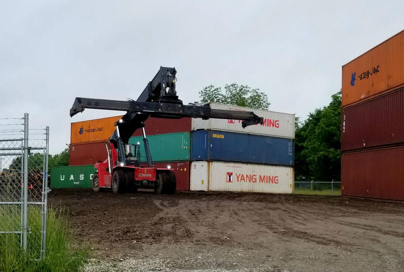A loader prepares to grab a container unit.