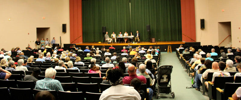 People start to fill the East Columbus High School auditorium.