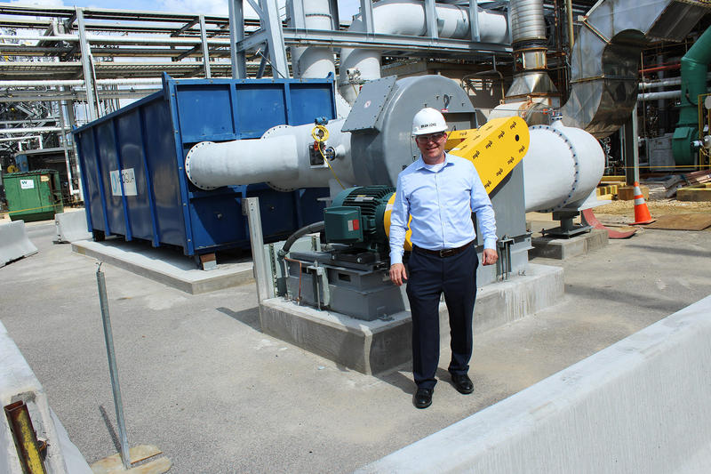 Brian Long, the plant manager, in front of a new carbon adsorption unit at Chemours.