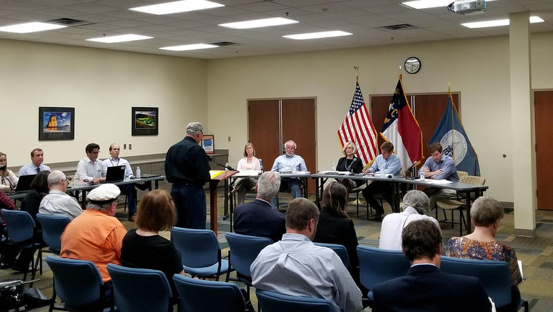 The New Hanover County Planning Board listens as a resident comments on the proposed UDO.