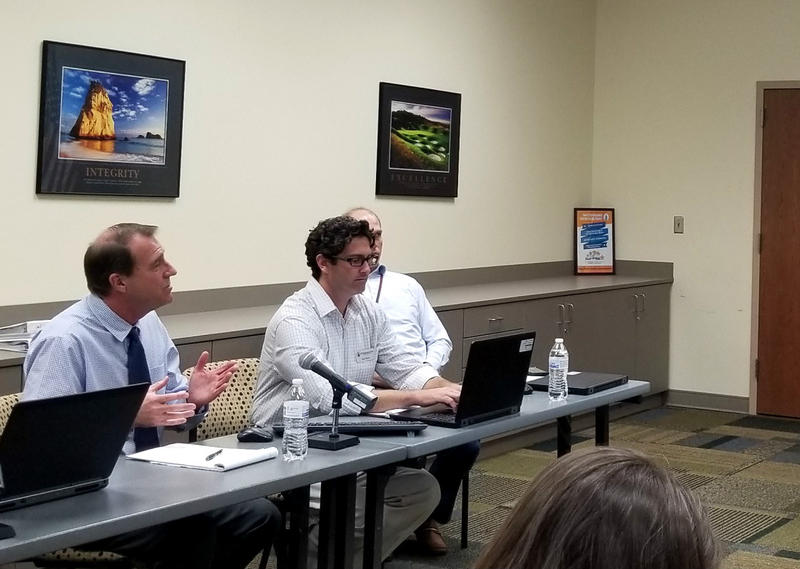 New Hanover County Planning Director Wayne Clark (left) explains the UDO process during Tuesday's meeting.