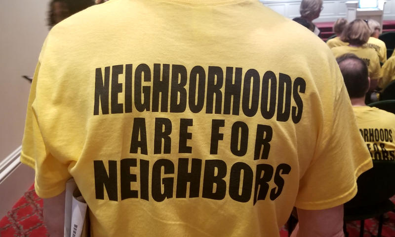 Many in attendance wore these yellow shirts.