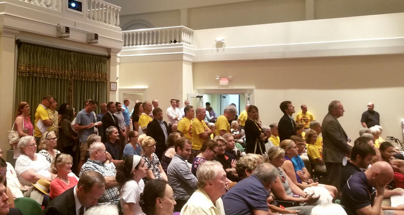 Residents get in line to address the city council Tuesday night.