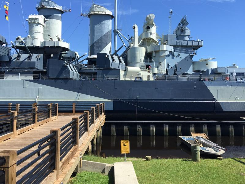 The USS North Carolina sits across the Cape Fear River from downtown Wilmington.  The area is host to several alligators.