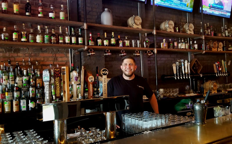Rebellion General Manager behind the bar downtown.